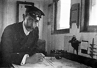 BNPS.co.uk (01202 558833)<br /> Pic: HAldridge/BNPS<br /> <br /> Philip Bell in the chart room of the RMS Albany, his remakable photo album is being auctioned.<br /> <br /> A remarkable photo album taken by a White Star line officer Philip Agathos Bell that contains haunting before-and-after images of the most senior officer to survive the Titanic disaster has come to light.<br /> <br /> The contrasting snaps of Second Officer Charles Lightoller show him stood proudly and confidently in his White Star Line uniform in and then one of him looming gaunt and drawn from his recent ordeal.<br /> <br /> Another incredible image shows the football team for While Star Line.