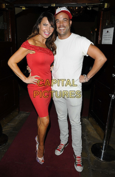 Lizzie Cundy &amp; Nate James<br /> 'Wag! The Musical' VIP Night at the Charing Cross Theatre, London, England.<br /> August 7th 2013<br /> full length white t-shirt red baseball cap hat jeans denim lace off the shoulder dress hand on hip<br /> CAP/CAN<br /> &copy;Can Nguyen/Capital Pictures
