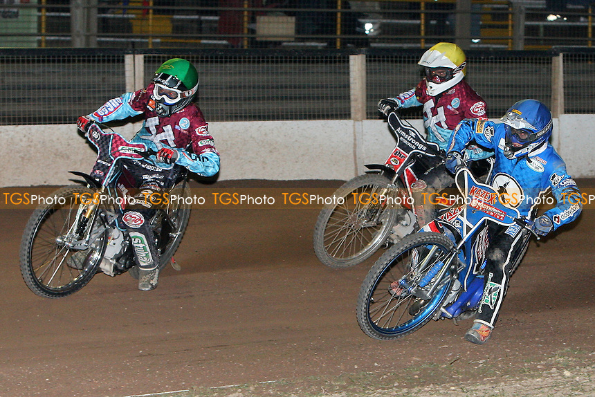 Heat 8 re-run: Dawid Stachyra (blue) inside Lakeside pair Joonas Kylmakorpi (green) and Stuart Robson (yellow) - Ipswich Witches vs Lakeside Hammers - Speedway Challenge Match First Leg at Foxhall Stadium, Ipswich, Suffolk - 19/03/09 - MANDATORY CREDIT: Gavin Ellis/TGSPHOTO - Self billing applies where appropriate - 0845 094 6026 - contact@tgsphoto.co.uk - NO UNPAID USE.