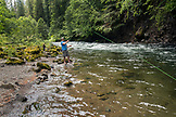 USA, Oregon, Santiam River, Brown Cannon, a man fishing along the Santiam River in the Willamete National Forest