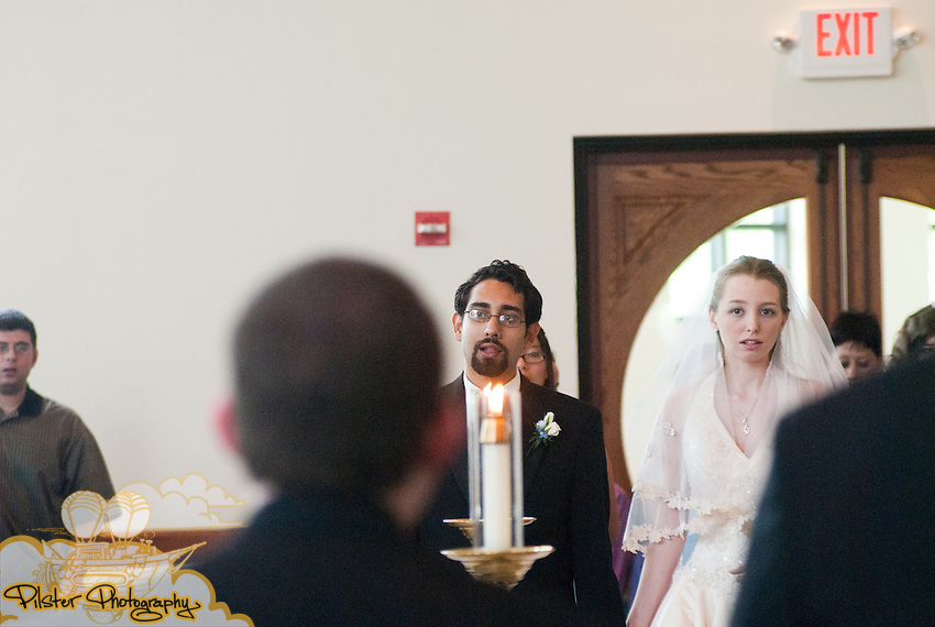 Rebecca Fraley and Gian-Karlo Alvarez during their wedding on Saturday, May 28, 2011, at Sts. Peter and Paul Catholic Church in Winter Park, Florida. (James Shaffer for Pilster Photography http://www.PilsterPhotography.net)