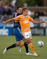 22 May 2008: Stuart Holden of the Dynamo controls the ball away from Ryan Cochrane of the Earthquakes during the first half of the game at Buck Shaw Stadium in San Jose, California.   San Jose Earthquakes and Houston Dynamo are tied 0-0 at halftime.