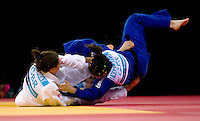 04 DEC 2011 - LONDON, GBR - Sally Conway (GBR) (in white, on left) wins by Ippon in the final few seconds of the Golden Score round of her semi final contest against Laura Vargas Koch (GER) (in blue, on right) at the London International Judo Invitational and 2012 Olympic Games test event at the ExCel Exhibition Centre in London, Great Britain (PHOTO (C) NIGEL FARROW)