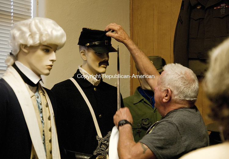 TORRINGTON, CT - 19 JUNE 2014 --Leonard Dube, director of the Torrington Veteran Services Office and Military Museum in Torrington adjusts a cap on a mannequin depicting a Civil War soldier added to the museum collection Thursday. The display was added in memory of the late Edward D. Zeiner Sr. who was a Civil War reenactor. Alec Johnson/ Republican-American