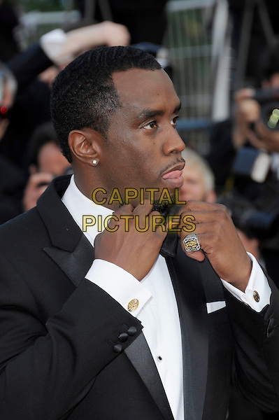 P Diddy aka Sean Combs.'Lawless' screening at the 65th  Cannes Film Festival, France 19th May 2012.p.diddy puffy puff daddy half  length black tuxedo tux bow tie hands earring ring tongue funny profile .CAP/PL.©Phil Loftus/Capital Pictures.