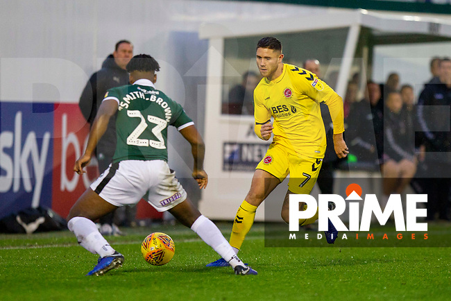 Wes Burns of Fleetwood Town takes on Ashley Smith-Brown of Plymouth Argyle during the Sky Bet League 1 match between Plymouth Argyle and Fleetwood Town at Home Park, Plymouth, England on 25 November 2018. Photo by Mark Hawkins / PRiME Media Images.