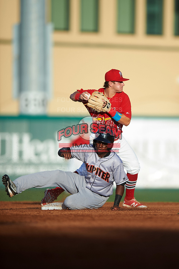 Palm Beach Cardinals second baseman Dylan Tice (8) throws to first as Junior Sosa (4) slides in during a game against the Jupiter Hammerheads  on August 12, 2016 at Roger Dean Stadium in Jupiter, Florida.  Jupiter defeated Palm Beach 9-0.  (Mike Janes/Four Seam Images)