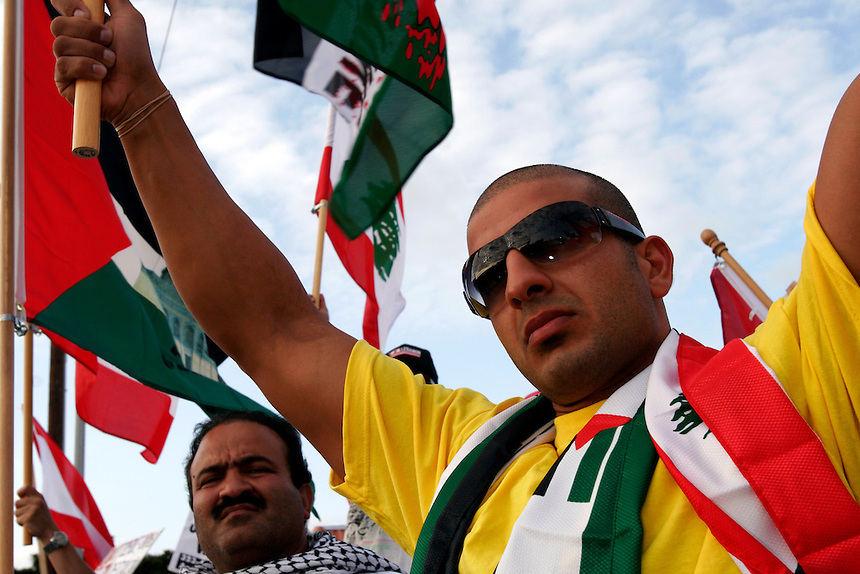 Mohammed Barakat, 24, stands amongst a crowd of several hundred gathered for a rally promoting the safety of civilians in Lebanon on Brookhurst Street in Anaheim, Calif., Saturday, July 29, 2006.  The protest was organized by the Council on American-Islamic Relations in response to the recent fighting between Israel and Hezbollah in Lebanon. (Photo by Bryce Yukio Adolphson/Brooks Institute of Photography, ©2006)