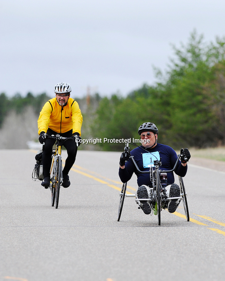Paced by a race official, Dean Juntunen turns a corner during the annual Journey's Marathon, Eagle River, WI, Saturday, May 9, 2009. The Mass City, MI man won the wheelchair division in a time of 02:10.05.