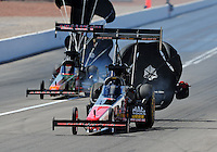 Apr. 3, 2011; Las Vegas, NV, USA: NHRA top fuel dragster driver David Grubnic (right) after defeating Terry McMillen during the Summitracing.com Nationals at The Strip in Las Vegas. Mandatory Credit: Mark J. Rebilas-