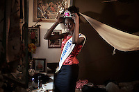 KINSHASA, DRC - JULY 17: Vanessa Nsul Kilem, age 21, poses for a portrait in her home in Petro Congo district of Kinshasa on July 17, 2014.  She dreams of becoming a super model. She has won local beauty pageants and she was one of 2000 girls casting for the thirty spots to participate in Kinshasa Fashion Week at Shark club in Kinshasa, DRC. Local and invited foreign-based designers showed their collections during the second edition of Kinshasa Fashion week. (Photo by Per-Anders Pettersson)