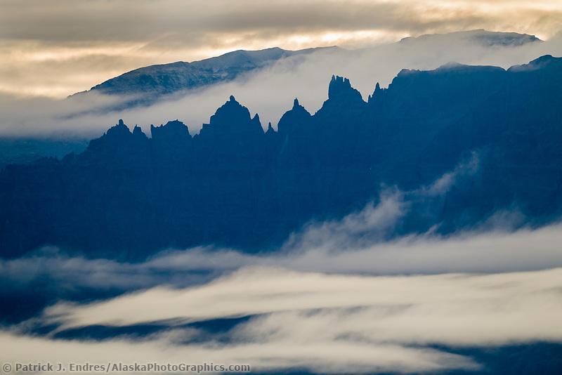 Fog hovers over the spires of mount Katolinat of the Kejulik mountains, Katmai National Park, southwest, Alaska.