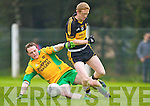 Gneeveguilla's Mike B Murphy tackles Colm Cooper of Dr Crokes in Gneeveguilla last Sunday evening in round 1 of the Garvey's Supervalue County Senior Championship.