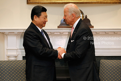 United States Vice President Joe Biden (R) and Vice President Xi Jinping of China shake hands before an expanded bilateral meeting with other U.S. and Chinese officials in the Roosevelt Room at the White House February 14, 2012 in Washington, DC. While in Washington, Vice President Xi will meet with Biden, President Barack Obama and other senior Administration officials to discuss a broad range of bilateral, regional, and global issues.  .Credit: Chip Somodevilla / Pool via CNP