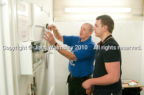 Instructor with a student electrician, Able Skills, Dartford, Kent.