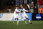 New Mexico's Blake Danaher (5) congratulates teammate Brandon Barklage (4) on his 20th minute goal, which gave New Mexico a 1-0 lead. The University of New Mexico defeated Clemson University 2-1 in the NCAA Semifinal at SAS Stadium in Cary, North Carolina, Friday, December 9, 2005.
