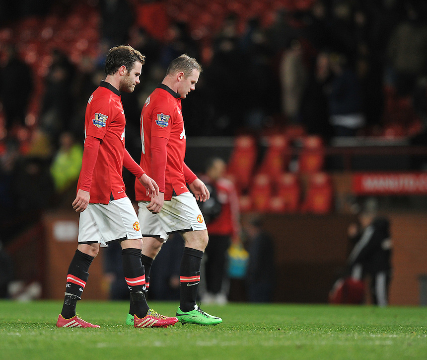 Manchester United's Juan Mata and Wayne Rooney show their frustration at their team conceding a last minute equalising goal<br /> <br /> Photo by Dave Howarth/CameraSport<br /> <br /> Football - Barclays Premiership - Manchester United v Fulham - Sunday 9th February 2014 - Old Trafford - Manchester<br /> <br /> &copy; CameraSport - 43 Linden Ave. Countesthorpe. Leicester. England. LE8 5PG - Tel: +44 (0) 116 277 4147 - admin@camerasport.com - www.camerasport.com