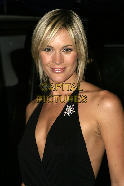 JENNI FALCONER.British Comedy Awards 2004, London Television Studios, London, December 22nd 2004..portrait headshot jenny black halterneck dress brooch broach.Ref: AH.www.capitalpictures.com.sales@capitalpictures.com.©Capital Pictures.