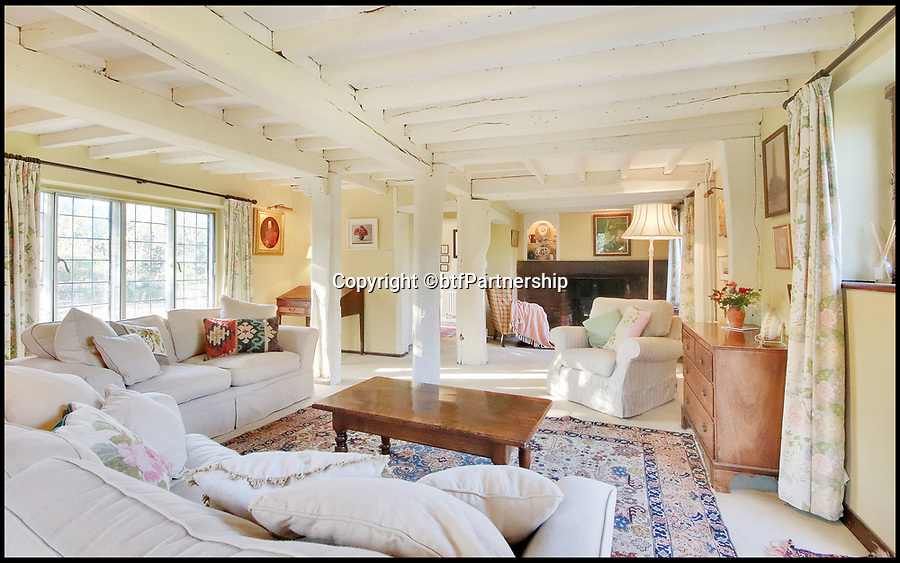 BNPS.co.uk (01202 558833)<br /> Pic:  btfPartnership/BNPS<br /> <br /> What a corker!<br /> <br /> A charming period farmhouse that comes with its own vineyard is the perfect investment for a homebuyer with a lot of bottle.<br /> <br /> Walnut Tree Farm, near Ashford, Kent - on the market for £920,000 - is in a beautiful rural spot but less than an hour from London.<br /> <br /> It has a private vineyard of 1.5 acres with grape varieties including chardonnay, pinot noir and pinot meunier and produces between 300 and 500 bottles a year, depending on the harvest.<br /> <br /> The farmhouse was originally an apple store for the large Dering estate, owned by the Dering family of baronets, until a lot of the farmland and buildings were sold off in the early 20th century.