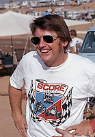 Mickey Thompson at the AC-Delco World Championships of Off-Road Racing, Riverside International Raceway, Riverside CA, Sept 5, 1975.  The idea of staging off-road racing for a live audience was Thompson's, who founded SCORE (Short course off-road events) in 1972. Photo by John G. Zimmerman.