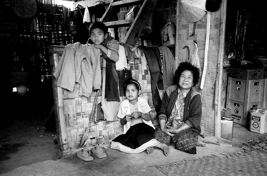 "Mekong Dam Victims - Laos.  A family waiting to be relocated for the second time as soon as the expansion of the dam will be completed. Asking what she thinks about moving again she said that ""the state is like ones parents... you always do what they say."" After the construction of the Theun-Hinboun Dam in Laos more than 29,000 people in 71 villages have lost fisheries, rice fields, vegetables gardens and fresh drinking water supplies as a result of the dam. An expansion project is currently under construction and will displace another 4,200 mostly indigenous people from their lands in the reservoir area and displace or negatively affect another 50,000 people living downstream, on project construction lands, and in resettlement host villages. Known as ""The Mother of Waters"", more than 60 million people depend on the Mekong river and its tributaries for food, fresh water, transport and other aspects of daily life. The construction of big dams is now threatening the life of these people aswell as the vital and unique ecosystem of the river."