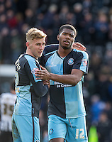 Jason McCarthy of Wycombe Wanderers & Rowan Liburd (Loanee from Reading) of Wycombe Wanderers after the final whistle during the Sky Bet League 2 match between Notts County and Wycombe Wanderers at Meadow Lane, Nottingham, England on 28 March 2016. Photo by Andy Rowland.