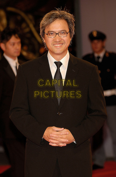"BENNY CHAN.Premiere of the film ""Rob-B-Hood"" (Bo bui gai wak) at the 63rd Venice Film Festival, Venice, Italy. .September 8th, 2006.Ref: KRA.half length black suit jacket.www.capitalpictures.com.sales@capitalpictures.com.©Persun/Capital Pictures"
