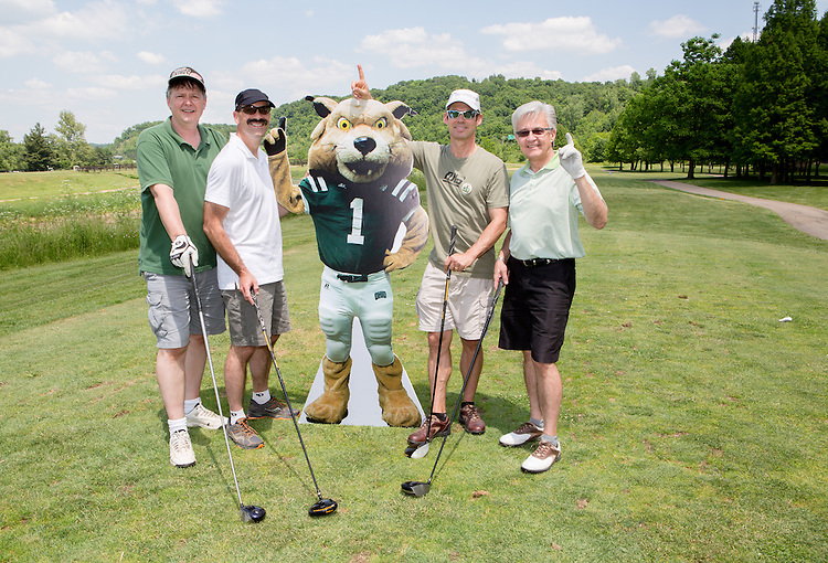 Left to right: Mike Podolski, Bruce Ramsey, Dan McNeil, and Ralph Phillips at the alumni golf outing. Photo by Lauren Pond