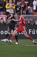 DC United midfielder Chris Pontius (13) tries to make a pass while covered by Chicago Fire defender Daniel Woolard (24)  Chicago Fire tied DC United 1-1 at  RFK Stadium, Saturday March 28, 2009.