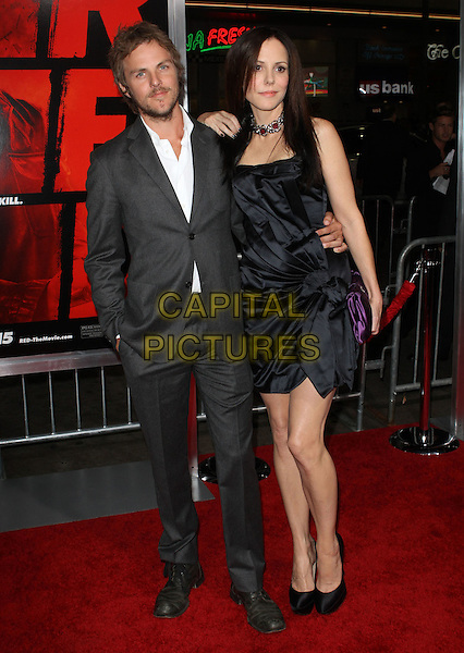 "CHARLIE MARS & MARY LOUISE PARKER.""RED"" Los Angeles Special Screening held at Grauman's Chinese Theatre, Hollywood, California, USA. .October 11th, 2010 .full length black choker necklace red  silver goth gothic hair straight dress clutch bag knotted grey gray suit jacket white shirt beard facial hair couple arm around waist silk satin purple.CAP/ADM/KB.©Kevan Brooks/AdMedia/Capital Pictures."