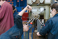 Using a pillar drill.  Apprentice engineering students at Kingston College..