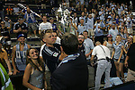 08 August 2012: Kansas City owner and team president Robb Heineman (foreground) hands the championship trophy to fans in the Members Stand. Sporting Kansas City won the championship over Seattle Sounders FC 3-2 on penalties after the game ended in a 1-1 tie at Livestrong Sporting Park in Kansas City, Kansas in the 2012 Lamar Hunt U.S. Open Cup Final.