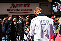 ESPN analyst and former men's national team defender Alexi Lalas signs autographs for fans during the centennial celebration of U. S. Soccer at Times Square in New York, NY, on April 04, 2013.