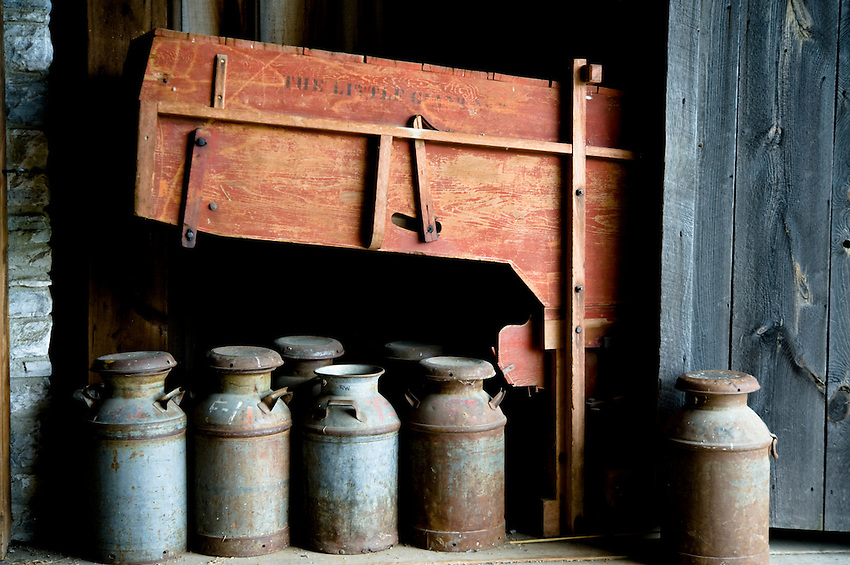 Wagon and storage containers in barn at Hancock Shaker Village in Massachussetts.