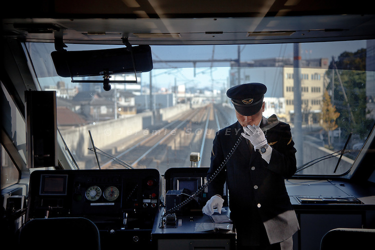 Himeji, November 25 2011 - A staff of Japan Railways on the Super Hakuto rapid train between Himeji and Tottori.