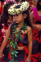 Leis adore the keiki (children) hula dancers at a Kamehameha Day festival on Kaua`i.