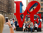 Manhattan, New York, U.S. - May 21, 2014 - On 6th Avenue, five girl friends pose for a group photo at the colorful LOVE sculpture by Robert Indiana, during a pleasant Spring day in Manhattan.