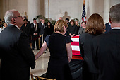 Family members of the late Supreme Court Justice John Paul Stevens participate in a ceremony as he lies in repose in the Great Hall of the Supreme Court in Washington, Monday, July 22, 2019.<br /> Credit: Andrew Harnik / Pool via CNP