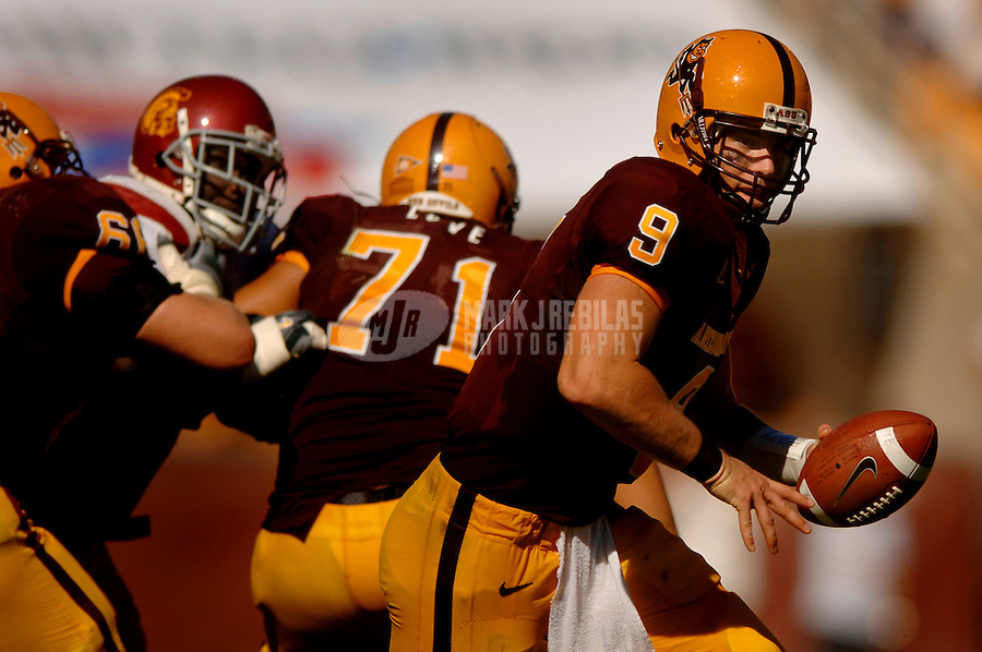 Oct 1, 2005; Tempe, AZ, USA; Arizona State Sun Devils quarterback #9 Sam Keller prepares to hand off the ball against the Southern California Trojans in the fourth quarter at Sun Devil Stadium. Mandatory Credit: Photo By Mark J. Rebilas