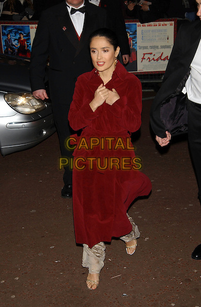 "SALMA HAYEK.At the film premiere ""Frida"", Leicester Square, London, UK..February 13th, 2003.red velvet wrap coat full length .CAP/PL.©Phil Loftus/Capital Pictures."