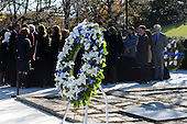 United States President Barack Obama talks with members of the Kennedy family after laying a wreath at the gravesite for President John F. Kennedy at Arlington National Cemetery in Arlington, Virginia, November 20, 2013. This Friday will mark the 50th anniversary of the assassination of President Kennedy.  <br /> Credit: Pat Benic / Pool via CNP