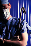 dramatic portrait of surgeon with crowbar over his shoulder
