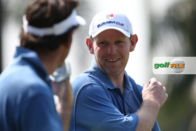 Team Europe's Stephen Gallacher (SCO) produced a winning 4&3 performance with Gonzalo Fdez-Castano (ESP) during the first day Foursomes at the 2014 Eurasia Cup presented by DRB-Hicom, at the Glenmarie Golf & Country Club, Kuala Lumpur, Malaysia. Picture:  David Lloyd / www.golffile.ie