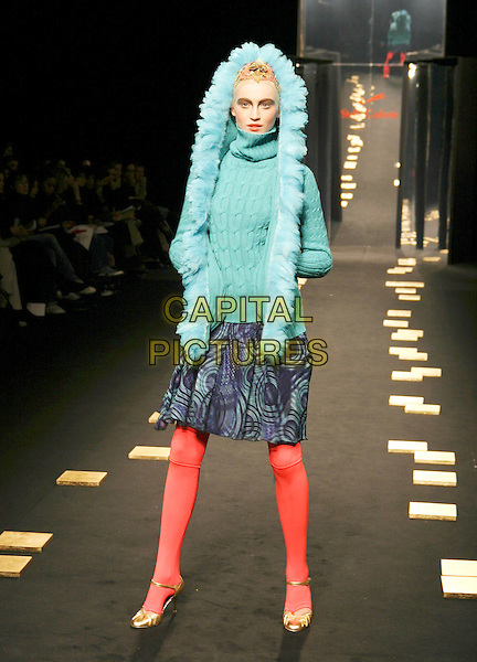 MODEL.Stella Cadente, Ready to Wear Collection Autunm/Winter 2005/2006, Paris, France,.2nd March 2005..full length fashion show catwalk runway blue hood top fur red tights.**UK SALES ONLY**.Ref: MDS.www.capitalpictures.com.sales@capitalpictures.com.©Virgille Biechy/O.Medias/Capital Pictures .