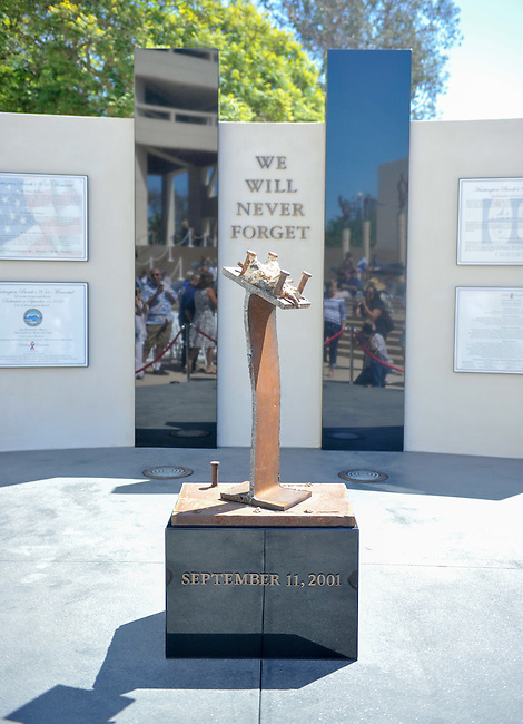 The new $200,000 9/11 memorial located at Huntington Beach city hall. The memorial features steel from the actual site of the 9/11 tragedy.<br /> <br /> ///ADDITIONAL INFORMATION: hb.0915.memorial – 9/11/16 – MICHAEL KITADA, ORANGE COUNTY REGISTER - _DSC8524.jpg - <br /> Summary: The Huntington Beach Police Officers' Foundation's 9-11 Memorial Committee unveils a $200,000 monument including steel from the toppled World Trade Center, at City Hall. The event will include music, a flyover, New York police and others with connections to the 9-11 rescue and victims of the tragedy.