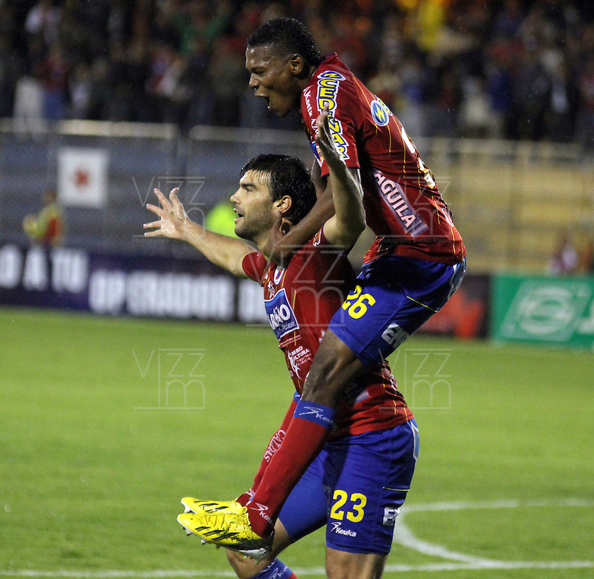 PASTO -COLOMBIA- 13-10--2013. Julian Lalinde (Abajo) celebra su gol con Nicolas Palacios contra La Equidad Seguros. Acción de juego correspondiente al partido entre los equipos Deportivo Pasto 4 y Seguros La Equidad 1 , partido de la  Liga Postobon segundo semestre jugado en el estadio La Libertad / Julian Lalinde celebratres his goal against Seguros La Equidad .Action game for the match between the teams Deportivo Pasto 3 and Equity Insurance 1 game in the second half played Postobon  League in the stadium La Libertad.Photo: VizzorImage / Stringer /