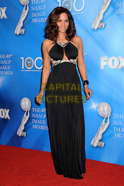 HALLE BERRY.40th Annual NAACP Image Awards - Press Room at the Shrine Auditorium, Los Angeles, California, USA..February 12th, 2009.full length long maxi black dress  silver beads beaded cut out away.CAP/ADM/BP.©Byron Purvis/AdMedia/Capital Pictures.