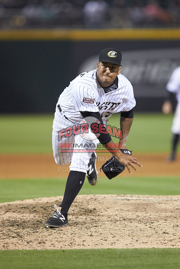 Charlotte Knights relief pitcher Gregory Infante (45) follows through on his delivery against the Indianapolis Indians at BB&T BallPark on May 26, 2018 in Charlotte, North Carolina. The Indians defeated the Knights 6-2.  (Brian Westerholt/Four Seam Images)