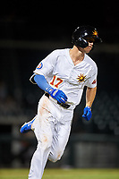 Mesa Solar Sox Jared Young (17), of the Chicago Cubs organization, runs to first base during an Arizona Fall League game against the Peoria Javelinas on September 21, 2019 at Sloan Park in Mesa, Arizona. Mesa defeated Peoria 4-1. (Zachary Lucy/Four Seam Images)