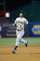 Malique Ziegler (2) of the Augusta GreenJackets rounds the bases after hitting a home run against the Greensboro Grasshoppers at First National Bank Field on April 10, 2018 in Greensboro, North Carolina.  The GreenJackets defeated the Grasshoppers 5-0.  (Brian Westerholt/Four Seam Images)